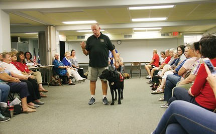 Program pairs canines with 'heroes'