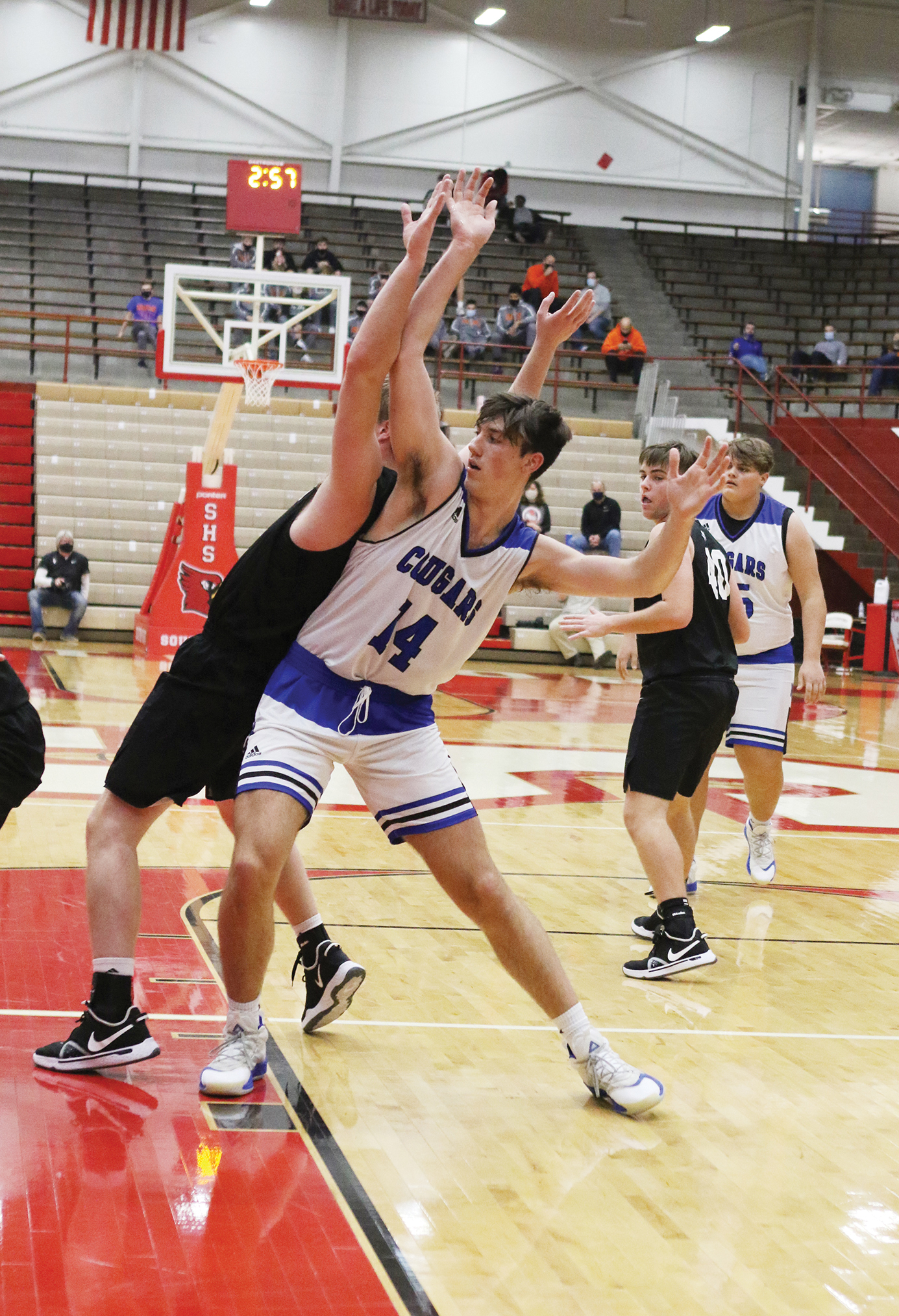 Tough test: Cougars split with pair of aces