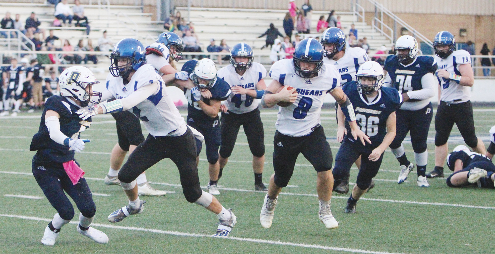Early offense, late defense lift Cougars