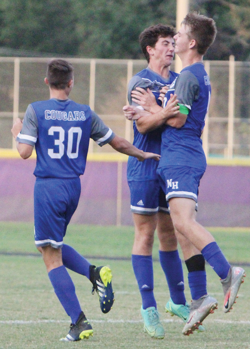 Late goals lift Cougars over Lions